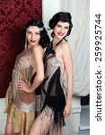two beautiful girls dressed in... | Shutterstock . vector #259925744