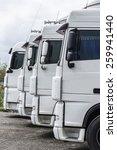 four white trucks of a... | Shutterstock . vector #259941440