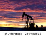 Pumpjack Silhouette With Oil...