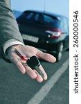 man in suit offering a car key...   Shutterstock . vector #260000546