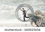 young businessman in suit... | Shutterstock . vector #260025656