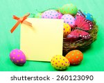easter greeting card with eggs... | Shutterstock . vector #260123090