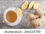 ginger tea in a white cup on... | Shutterstock . vector #260123750