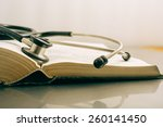Stethoscope And Books On White...