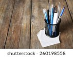 different pens in metal holder... | Shutterstock . vector #260198558