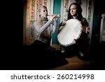 Two Beautiful Woman With ...