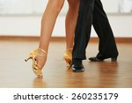 Stock photo beautiful womanish and masculine legs in active ballroom dance indoors 260235179