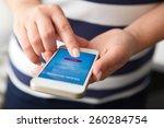 female hands using mobile... | Shutterstock . vector #260284754
