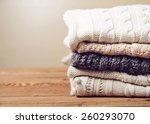 stack of clothes from knitted... | Shutterstock . vector #260293070