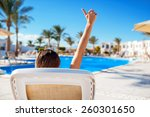 woman lying on a lounger by the ... | Shutterstock . vector #260301650