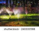 Garden Sprinkler On A Sunny...