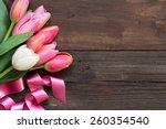pink and white tulips on dark...   Shutterstock . vector #260354540
