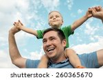 son seating on the father under ... | Shutterstock . vector #260365670