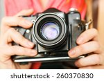 Woman Photographer Holding Old...