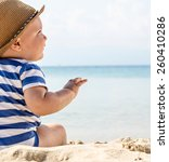 baby boy with hat sitting on... | Shutterstock . vector #260410286