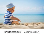 baby boy with hat sitting on... | Shutterstock . vector #260413814