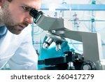 Scientist Looking Through A...