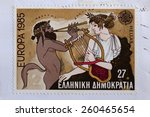 Small photo of GREECE - CIRCA 1985: Marsyas greek mythology satyr plays aulos double flute on music challenge against Apollo ancient god of music and the arts. Illustration on vintage Hellenic Post postage stamp.
