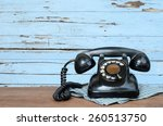 Old Telephone On Wood...