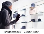 casualy winter dressed lady... | Shutterstock . vector #260547854