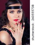 beautiful retro woman posing... | Shutterstock . vector #260555738