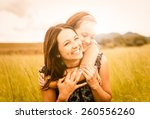 mother and child are hugging... | Shutterstock . vector #260556260