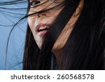 Asian Woman With Hair Flying O...