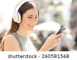 Woman Listening Wireless Music...