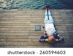 top view young woman lying on a ... | Shutterstock . vector #260594603