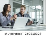young people working in the... | Shutterstock . vector #260610329