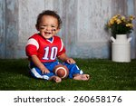 Adorable Baby Boy Sitting In...