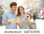 couple of tourists consulting a ... | Shutterstock . vector #260722550