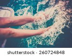 Female Legs Splashing Sea Wate...