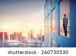 businessman is looking at city  | Shutterstock . vector #260730530