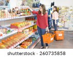 happy woman with shopping... | Shutterstock . vector #260735858
