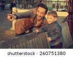 Stock photo father and little boy watching the sunset in amsterdam 260751380