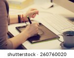 a graphic designer is working... | Shutterstock . vector #260760020