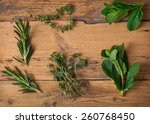 freshly clipped herbs on wooden ... | Shutterstock . vector #260768450