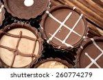 dark chocolate on wooden... | Shutterstock . vector #260774279