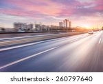 car driving on freeway at... | Shutterstock . vector #260797640