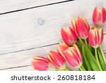 Colorful Tulips On Wooden Tabl...