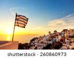 Greek Flag Waving At Sunset In...