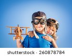 happy kids playing with vintage ... | Shutterstock . vector #260878784