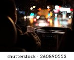 Driving in night scenery, hands on steering wheel. - stock photo