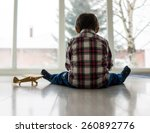 sad kid sitting on floor | Shutterstock . vector #260892776