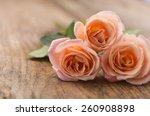 Three Orange Rose On Brown...