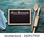 blank black board on wooden... | Shutterstock . vector #260927933