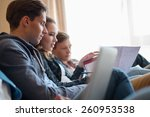 three young students preparing...   Shutterstock . vector #260953538