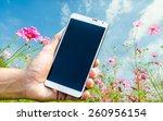 man hand holding smartphone... | Shutterstock . vector #260956154
