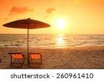 Beach Chair On The Beach With...